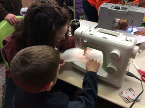 A child learning basic machine sewing