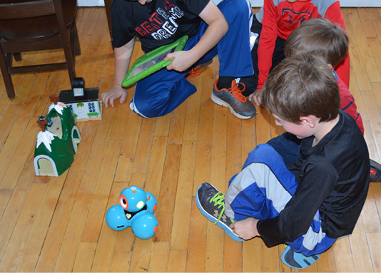 students playing with a Dash robot