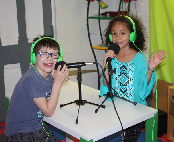 """Cy and Chloe recording the podcast, """"Buttons & Figs."""""""