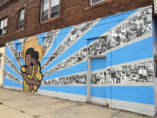 """""""Who We Are,"""" a mural designed by youth and adult artists in Juxtaposition Arts' Public Art Studio. Located at 1100 West Broadway Ave. in Minneapolis, Minnesota."""