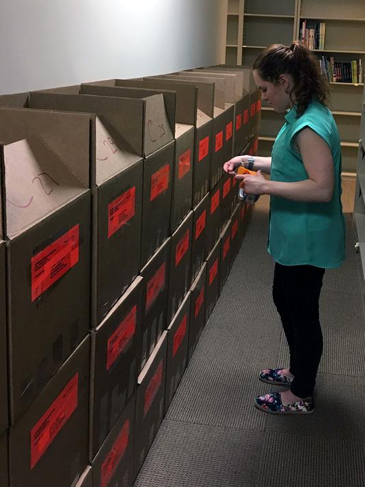 ALSC awards intern Corinne Demyanovich prepares the 2017 Bookapalooza award for shipment. Photo courtesy of ALSC.