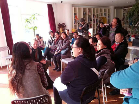 Participants in an early-morning storytime and parental Q&A listen to Echo Liu, owner of Beijing's Baby Cube Library and children's publishing house, respond to one of the author's points.