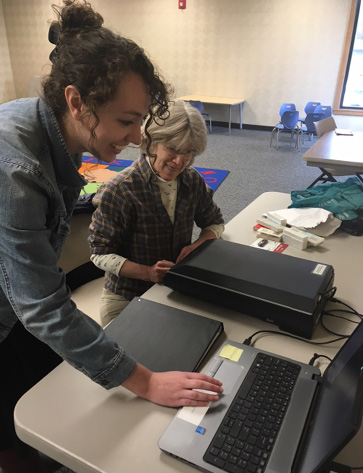 The author assists a patron during a program on digitizing photos.