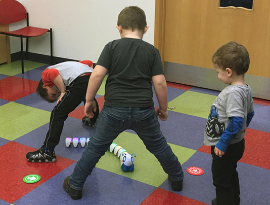 Open exploration is a great opportunity for kids to learn coding. These kids wrote the code for the Code-a-Pillar to go through their legs!